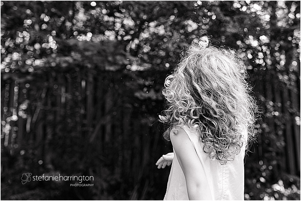 beautiful curly hair on a little girl as she twirls and plays
